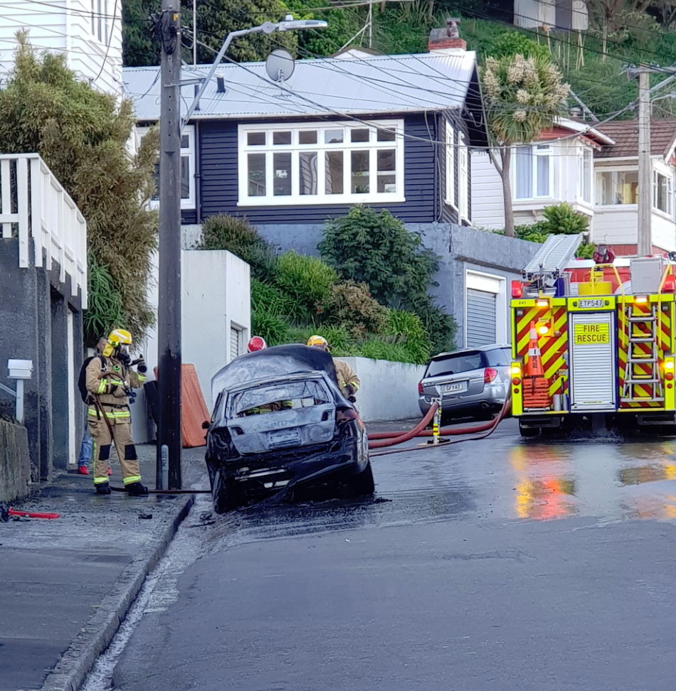 Wellington firefighters extinguish car fire on suburban road in Lyall Bay