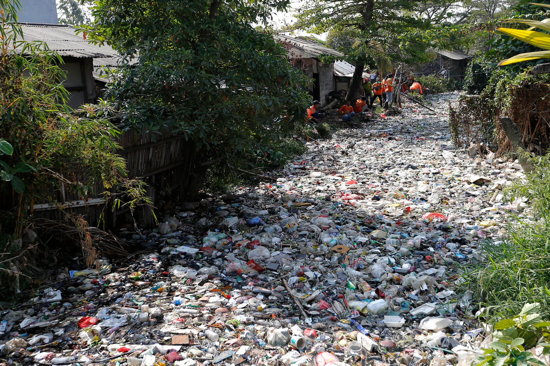 Shocking images of 'happy' river where you can't see water for the trash