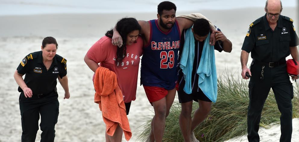 Sucked out to sea: Four exhausted swimmers plucked from rip