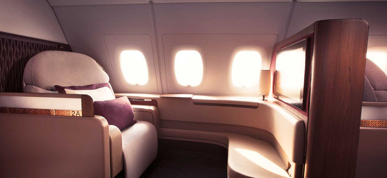 Flying from Doha to London aboard Qatar Airways, first class