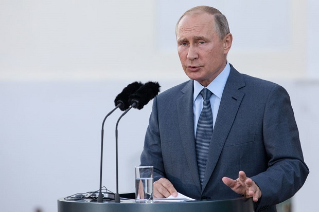 Vladimir Putin warns Russians about defecting to the West