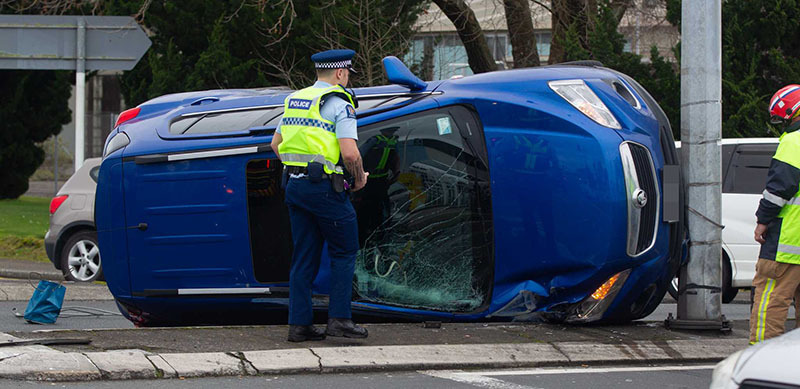 Car flipped after crash on Lake Rd - NZ Herald