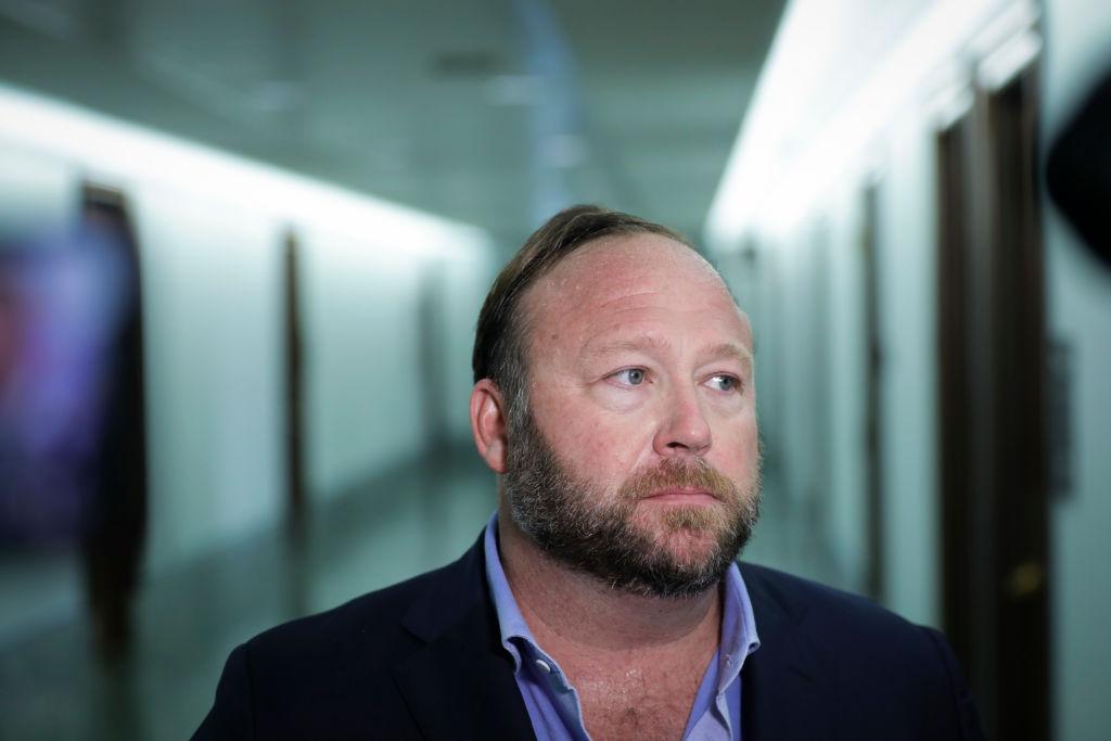 Alex Jones blames false Sandy Hook hoax claims on 'psychosis'