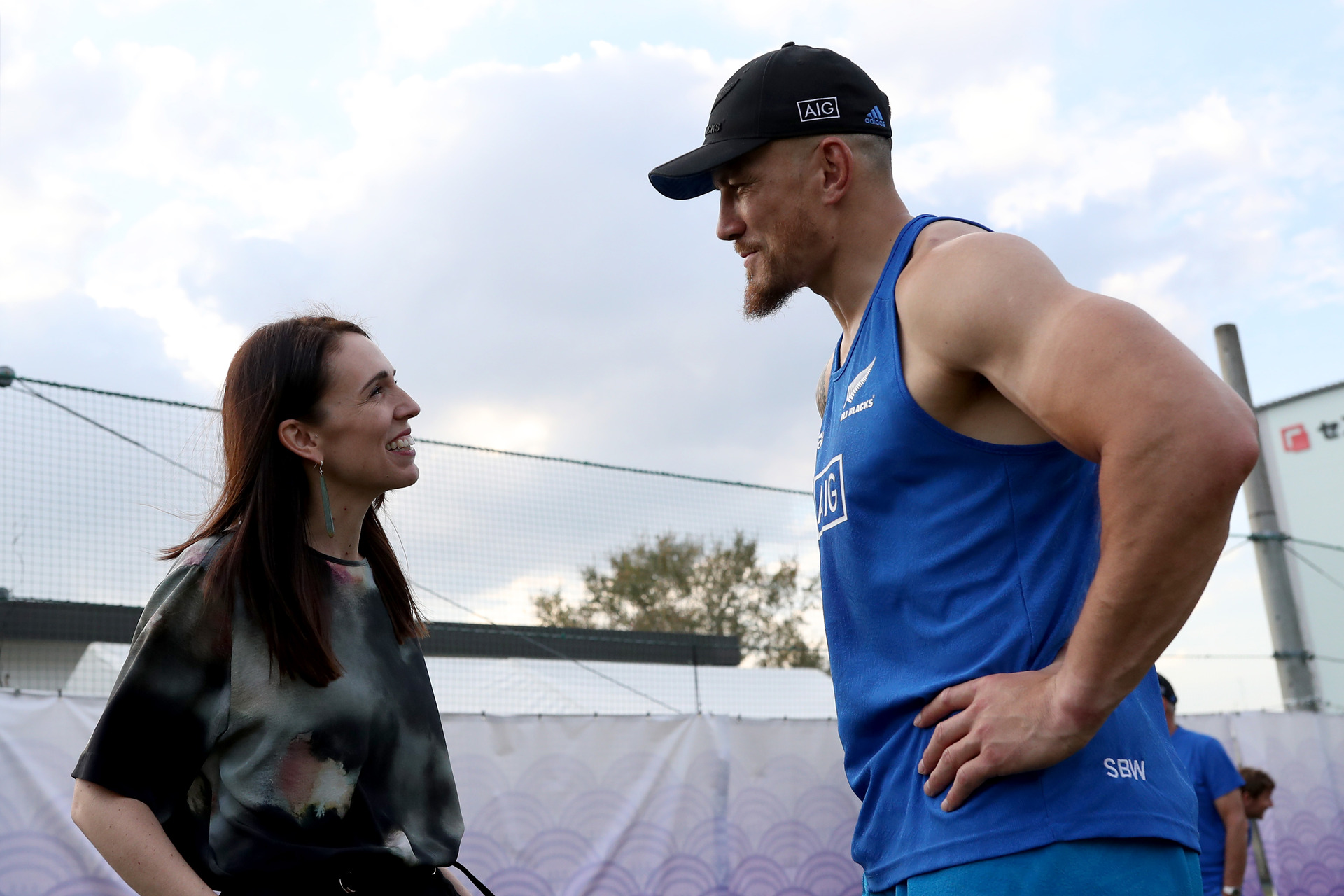 Ardern greets All Blacks ahead of opening ceremony