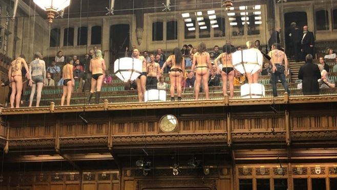 Bare cheek! Naked protesters flash British MPs