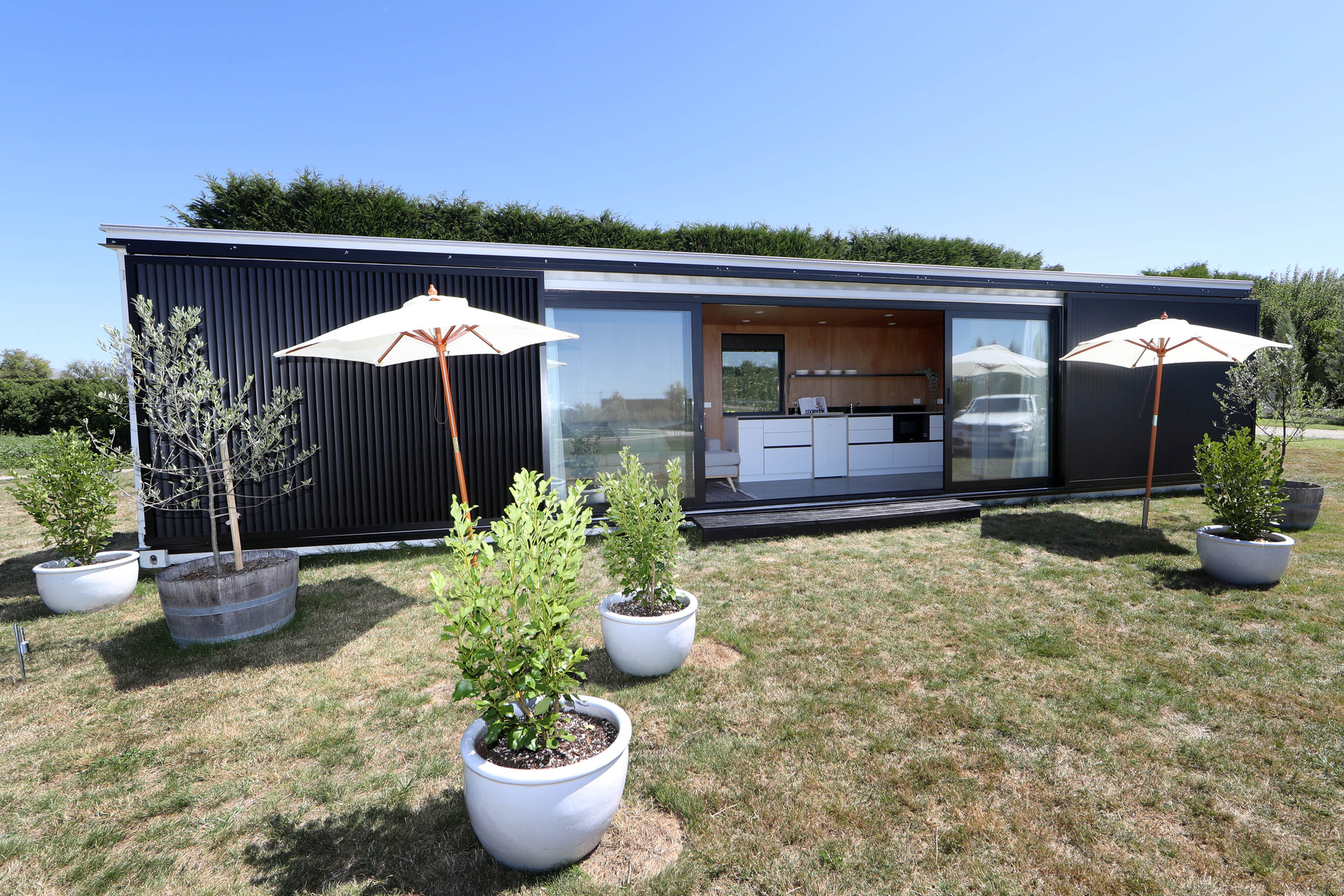 Tiny home makes thousands for cancer charity