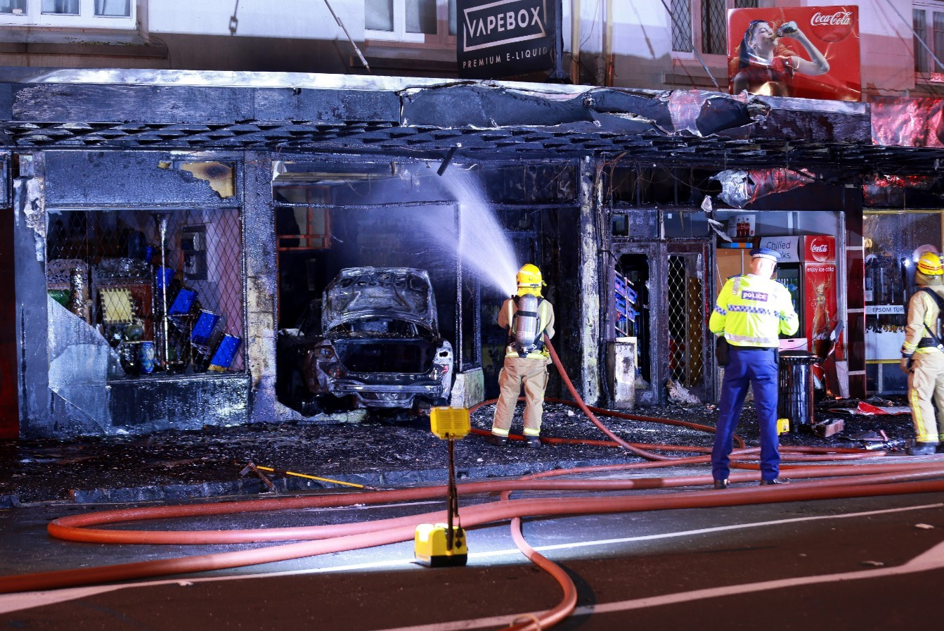 Car crashes into shop, burns it down - fire crews say it wasn't an accident