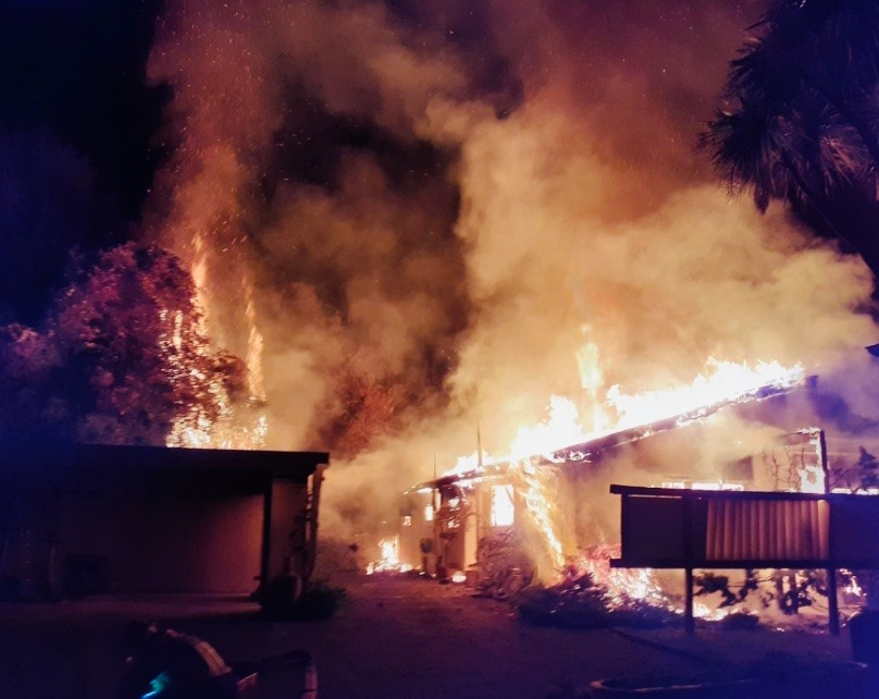Firefighter treated for heat exhaustion at huge house fire