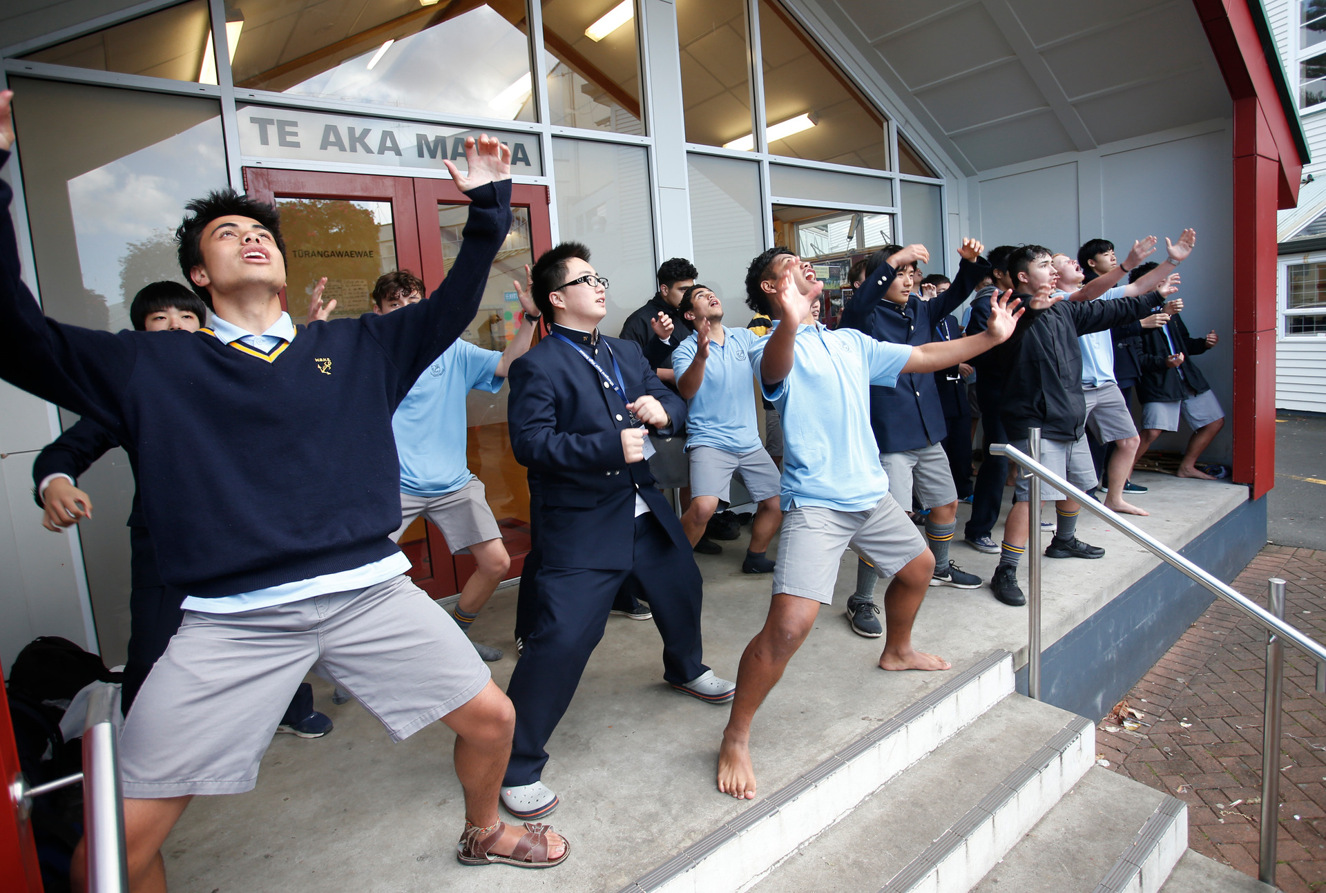 Japanese visitors learn the haka at Whangārei Boys High school