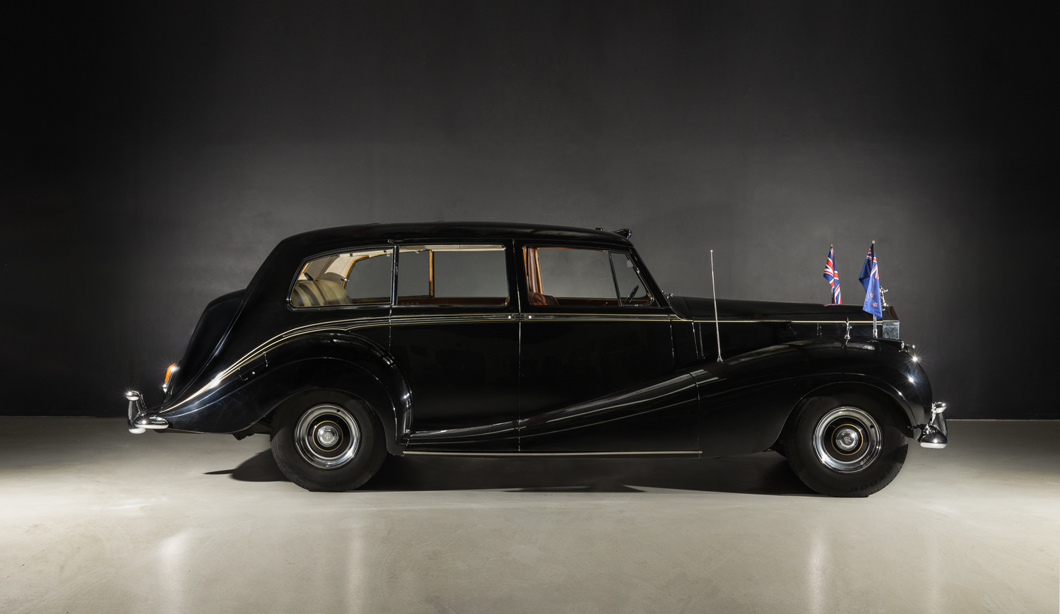 Queen's limo will remain in NZ after sale at rare classic car collection auction