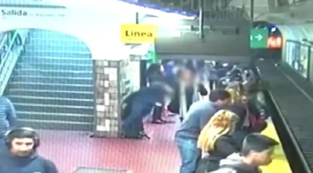Woman shoved onto train track by fainting man