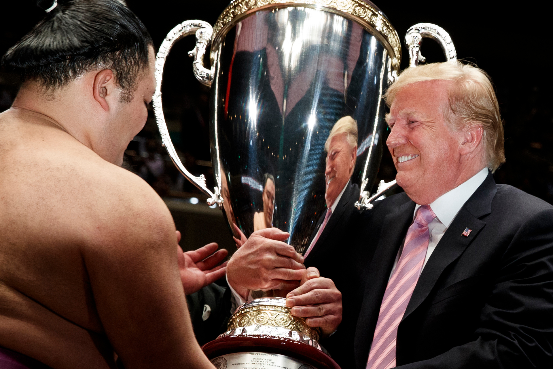 Donald Trump climbs into sumo ring in Japan to present 30kg trophy