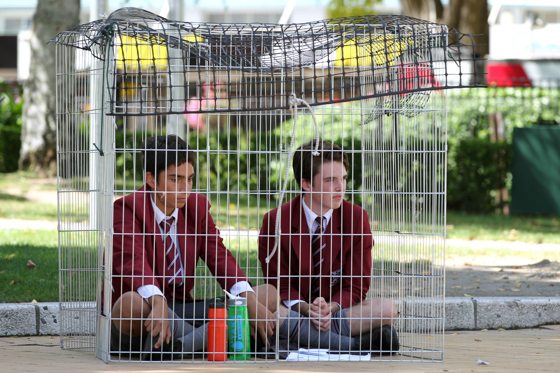 St John's College boys lock themselves in cage at Hastings clocktower in protest at prisoner conditions