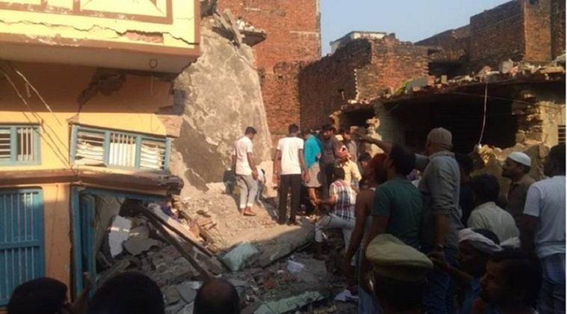 Building in India collapses, killing 12